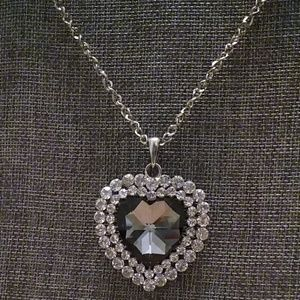 Jewelry - Long silver tone necklace with heart pendant